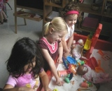 Preschoolers playing at the sensory table